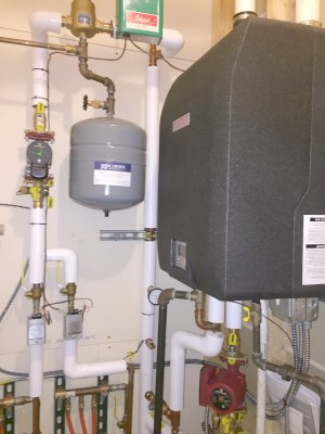 After: Replaced with a Lochinvar Cadet, high efficiency pump and insulated