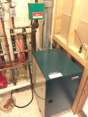 Before: Inefficient cast iron boiler for radiant heat