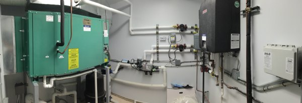 This is a custom indoor pool room that we did. High efficiency Lochinvar Cadet (Make and Model) Hot water boiler for the space heating and pool water heating, DHC (Manufacturer) dehumidification equipment custom built per job specifications and custom fabricated and installed duct work performed by us.
